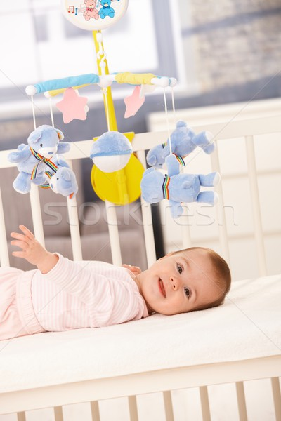 Smiling baby girl in bed Stock photo © nyul