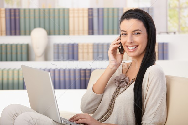 Laughing woman with laptop on call Stock photo © nyul