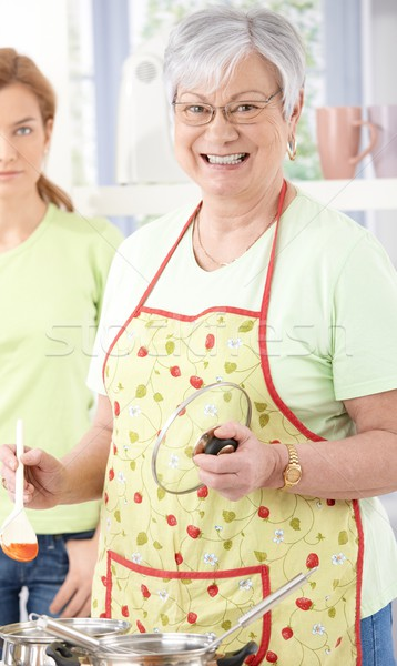 Idős nő főzés mosolyog konyha boldogan Stock fotó © nyul