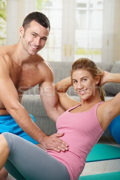 Abdominális testmozgás fiatal nő fitnessz otthon nappali Stock fotó © nyul