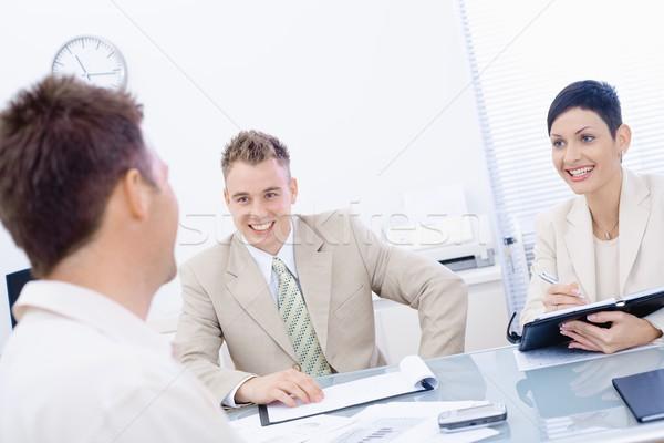 állásinterjú boldog üzletemberek iroda mosolyog papír Stock fotó © nyul