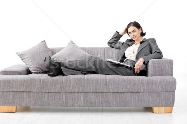 Stock photo: Businesswoman sitting on sofa