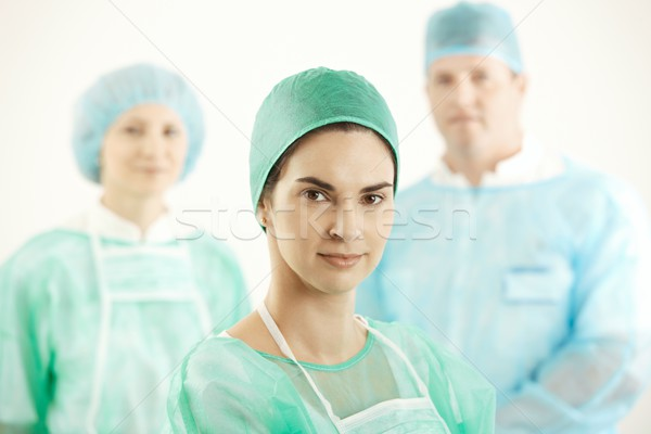 Confident surgeon with colleagues Stock photo © nyul