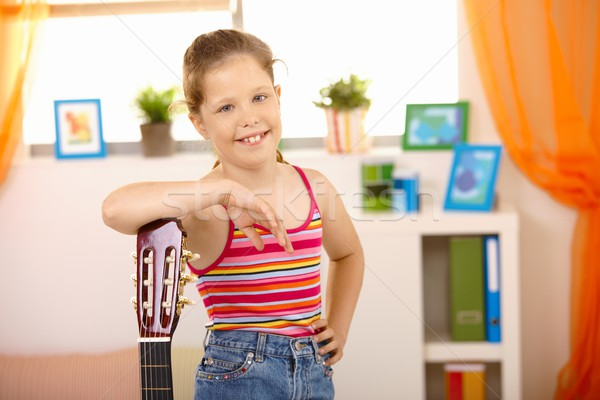 Portré boldog iskolás lány gitár pózol mosolyog Stock fotó © nyul