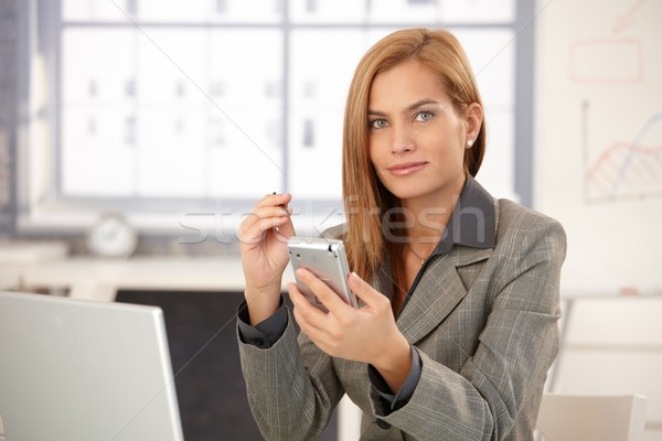 Portrait of businesswoman with PDA Stock photo © nyul