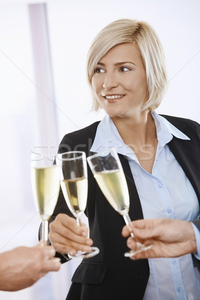 Businesswoman celebrating with champagne Stock photo © nyul