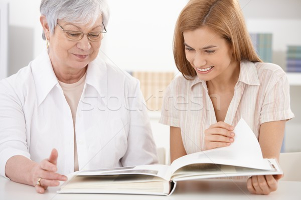 Senior mother and daughter looking at photo album Stock photo © nyul