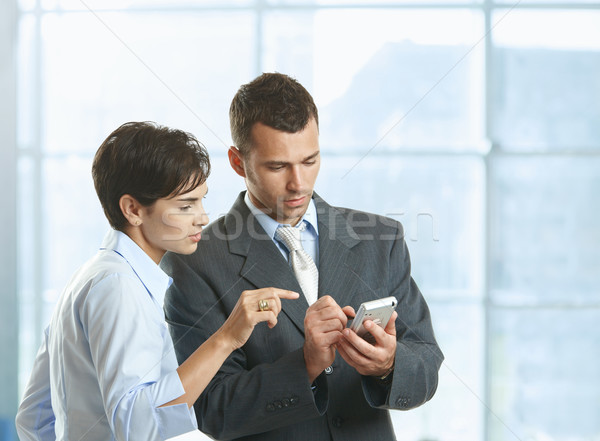 Businesspeople using mobile Stock photo © nyul