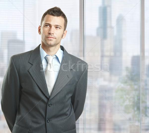 определенный бизнесмен Постоянный Windows центра служба Сток-фото © nyul