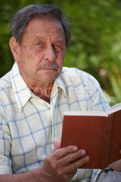Senior man reading book Stock photo © nyul