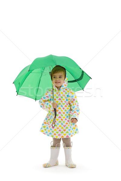 Faible fille parapluie heureux imperméable Photo stock © nyul