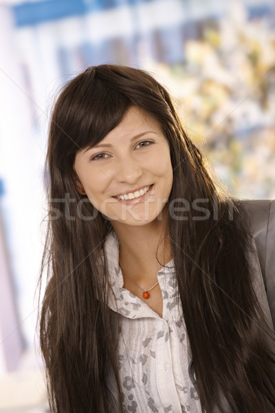 Smiling female office worker with long hair Stock photo © nyul