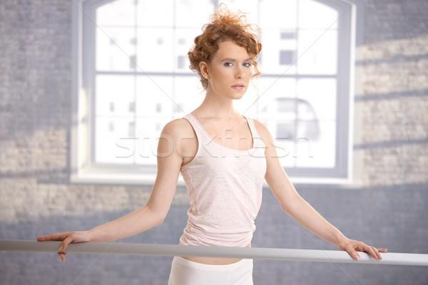 Pretty ballerina girl standing by bar practicing Stock photo © nyul