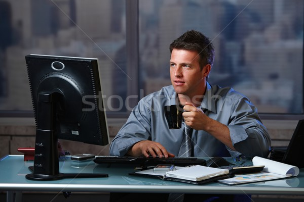 Tired businessman working late in office with coffee Stock photo © nyul