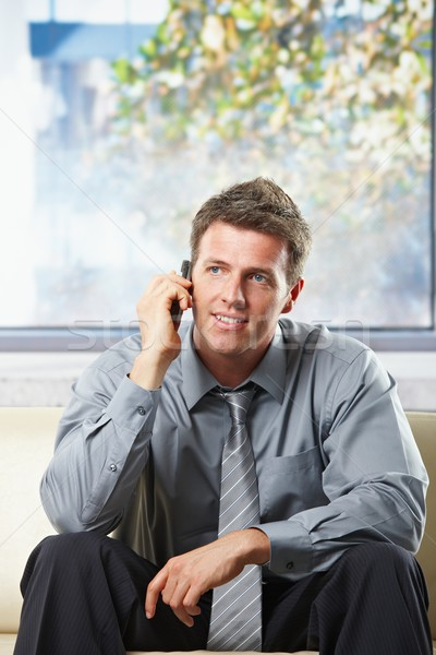 Stock photo: Happy professional getting news on phone