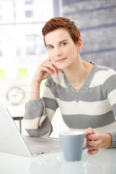 Young woman with coffee mug and laptop Stock photo © nyul