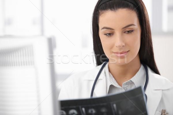 Portrait of doctor with Xray image Stock photo © nyul