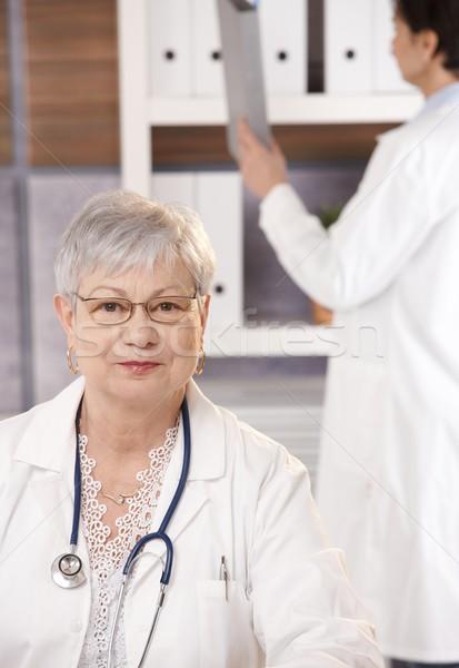 Stock photo: Portrait of senior doctor in office
