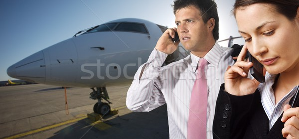 Businesspeople and corporate jet Stock photo © nyul