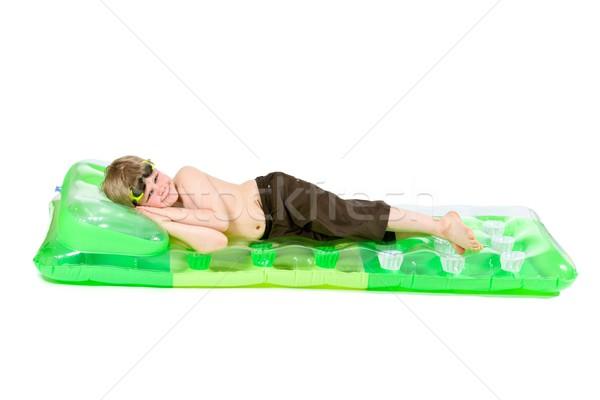 Peu garçon plage matelas heureux vert Photo stock © nyul
