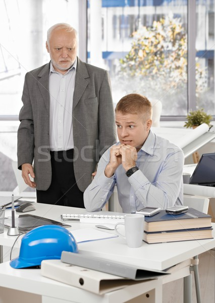 Scared office worker with angry executive Stock photo © nyul