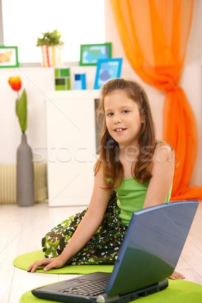 Portré kislány laptop ül padló laptop számítógép Stock fotó © nyul