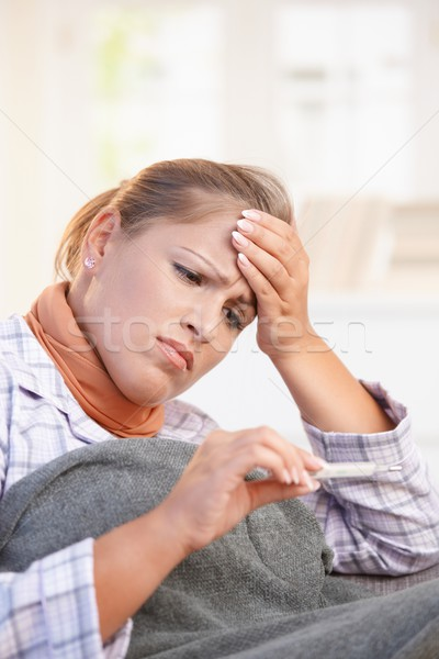 Young woman feeling bad taking her temperature Stock photo © nyul