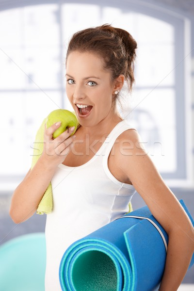 Pretty girl biting apple after workout Stock photo © nyul