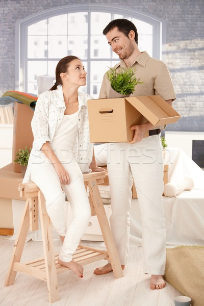 Young couple moving home unpacking boxes Stock photo © nyul