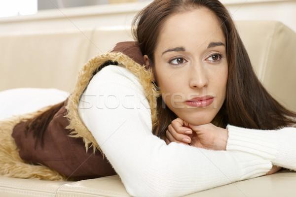 Fiatal álomszerű nő fiatal nő kanapé néz Stock fotó © nyul