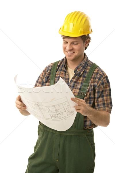 Handwerker halten Grundriss tragen lächelnd Stock foto © nyul