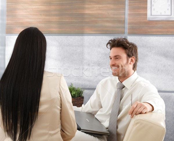Smiling businessman talking to woman Stock photo © nyul