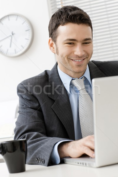Businessman using laptop Stock photo © nyul