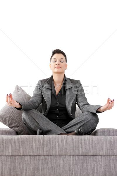 Mujer de negocios meditando jóvenes sesión sofá relajante Foto stock © nyul