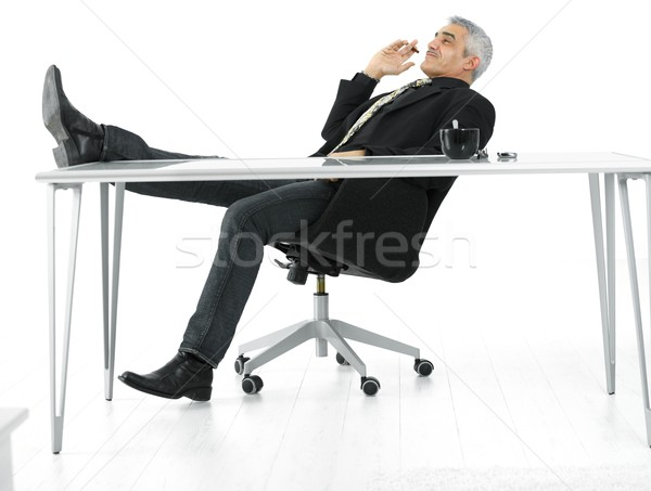 Confident businessman smoking cigar Stock photo © nyul