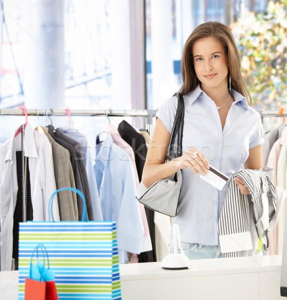 Woman paying at clothes shop Stock photo © nyul