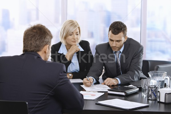 Businessteam reviewing documents Stock photo © nyul