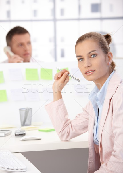 Attractive girl working in office Stock photo © nyul