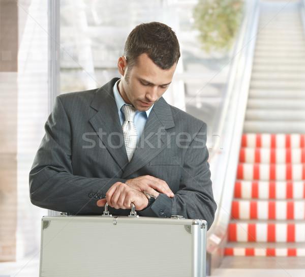 Businessman checking time Stock photo © nyul