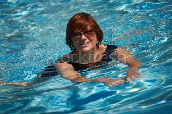 Stock fotó: Aktív · idős · nő · úszik · boldog · 60-as · évek