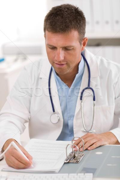 Lekarza pracy biuro mężczyzna lekarz twarz człowiek Zdjęcia stock © nyul