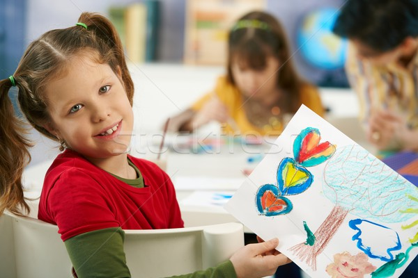 Child showing painting in art class Stock photo © nyul