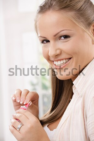 Happy girl with chewing gum Stock photo © nyul