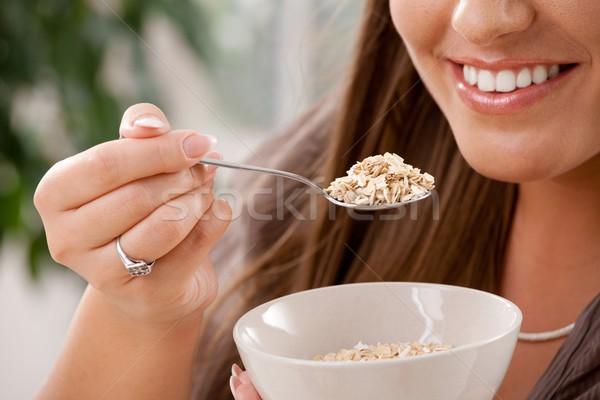 Woman eating cereal Stock photo © nyul