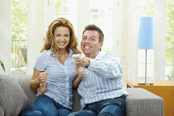 Excited couple watching TV Stock photo © nyul