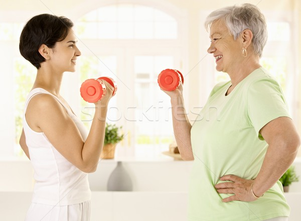 Elderly woman doing dumbbell exercise Stock photo © nyul