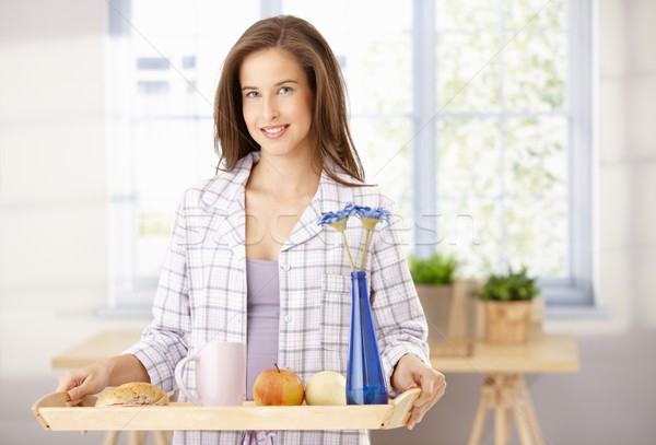 Happy woman with breakfast tray Stock photo © nyul