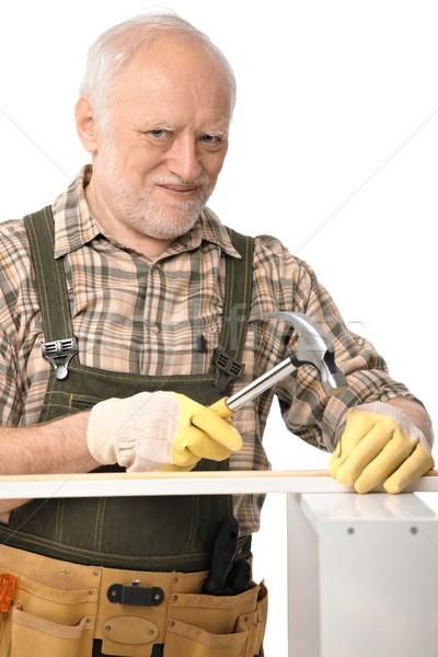Elderly man hammering Stock photo © nyul
