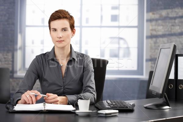 определенный деловая женщина сидят столе рабочих личные Сток-фото © nyul