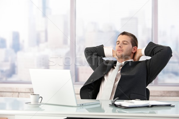 Young businessman stretching in office Stock photo © nyul